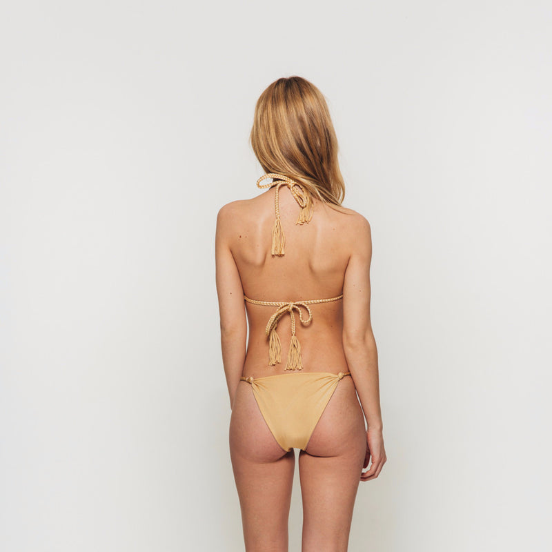 The Wanderlast djunah swimwear sunday bottom in gold bikini swimsuit back