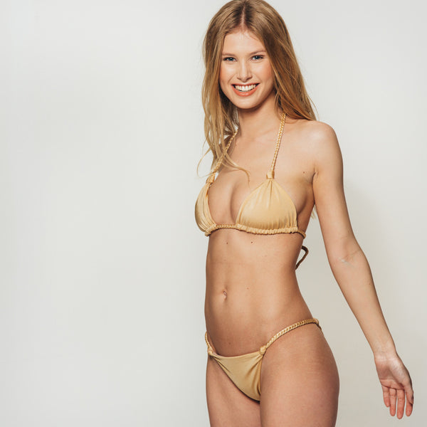 The Wanderlast djunah swimwear paradiso top in gold bikini swimsuit