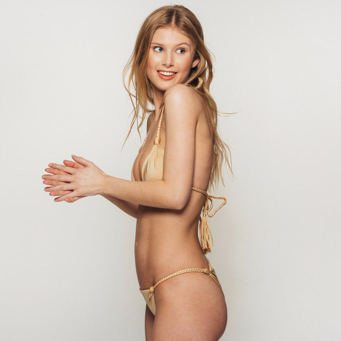 The Wanderlast djunah swimwear sunday bottom in gold bikini swimsuit side