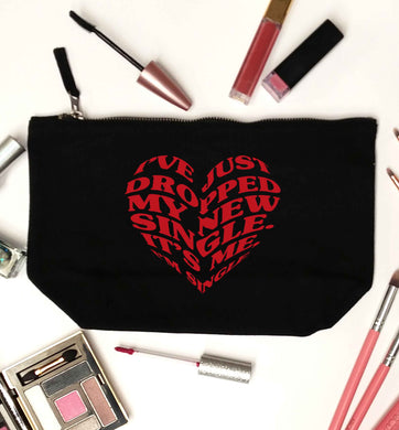 I've just dropped my new single it's me I'm single black makeup bag