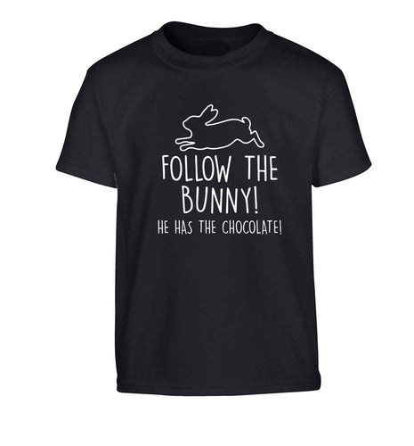Follow the bunny! He has the chocolate Children's black Tshirt 12-13 Years