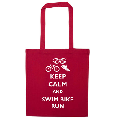 Keep calm and swim bike run red tote bag