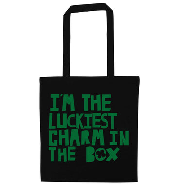 I'm the luckiest charm in the box black tote bag