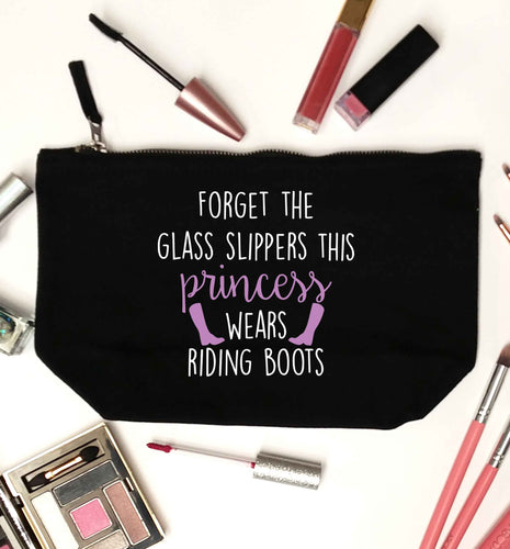 Forget the glass slippers this princess wears riding boots black makeup bag