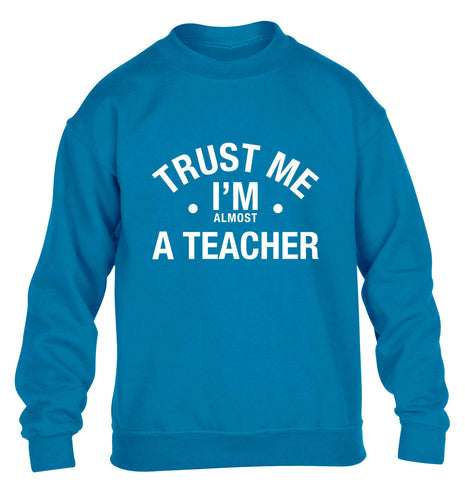 Trust me I'm almost a teacher children's blue sweater 12-13 Years