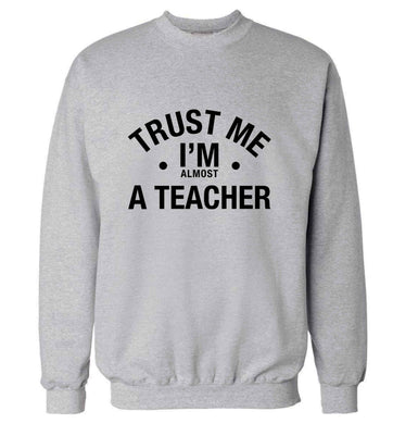Trust me I'm almost a teacher adult's unisex grey sweater 2XL
