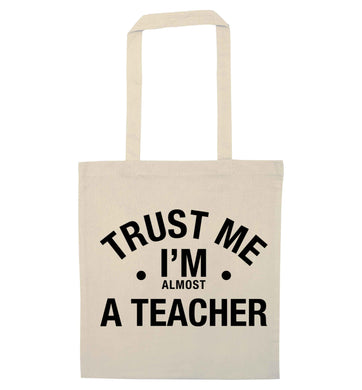 Trust me I'm almost a teacher natural tote bag