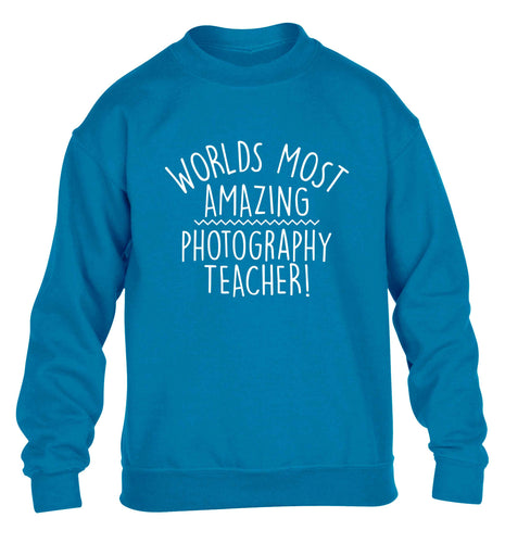 Worlds most amazing photography teacher children's blue sweater 12-13 Years