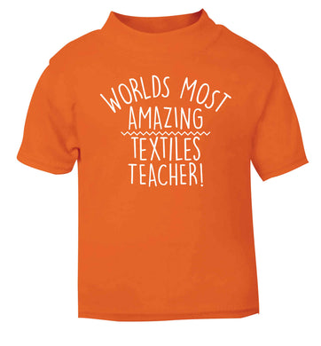 Worlds most amazing textiles teacher orange baby toddler Tshirt 2 Years