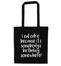 I eat cake because it's somebody's birthday somewhere! black tote bag