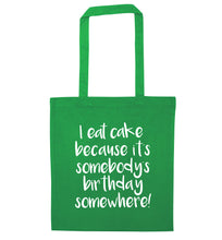 I eat cake because it's somebody's birthday somewhere! green tote bag
