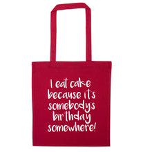 I eat cake because it's somebody's birthday somewhere! red tote bag