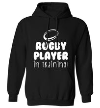 Rugby player in training adults unisex black hoodie 2XL
