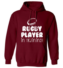 Rugby player in training adults unisex maroon hoodie 2XL
