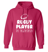 Rugby player in training adults unisex pink hoodie 2XL