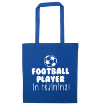 Football player in training blue tote bag