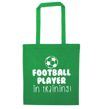 Football player in training green tote bag