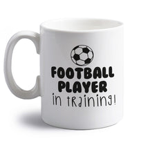 Football player in training right handed white ceramic mug