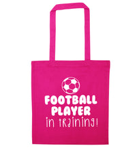Football player in training pink tote bag