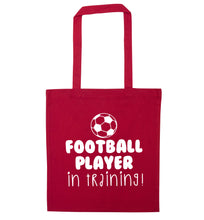 Football player in training red tote bag