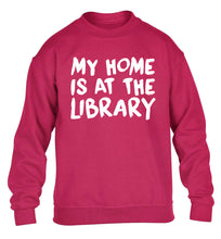 My home is at the library children's pink sweater 12-14 Years