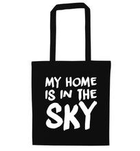 My home is in the sky black tote bag