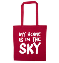 My home is in the sky red tote bag