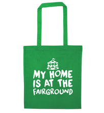 My home is at the fairground green tote bag