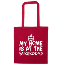 My home is at the fairground red tote bag