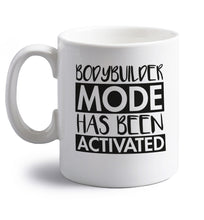 Bodybuilder mode activated right handed white ceramic mug
