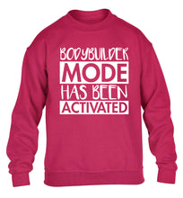 Bodybuilder mode activated children's pink sweater 12-14 Years