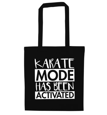 Karate mode activated black tote bag