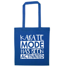 Karate mode activated blue tote bag