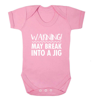 Warning may break into a jig baby vest pale pink 18-24 months