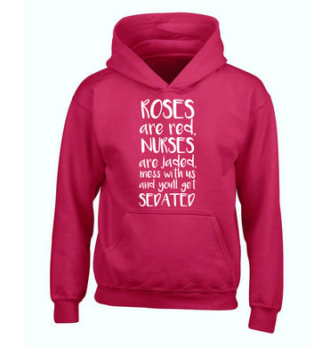 Roses are red, nurses are jaded, mess with us and you'll get sedated children's pink hoodie 12-14 Years