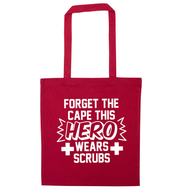 Forget the cape this hero wears scrubs red tote bag