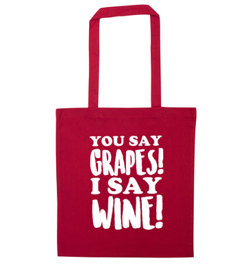 You say grapes I say wine! red tote bag
