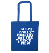 Keep santa healthy eat the mince pies blue tote bag