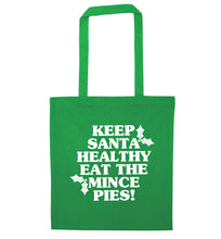 Keep santa healthy eat the mince pies green tote bag