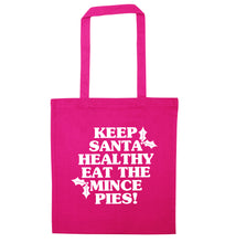 Keep santa healthy eat the mince pies pink tote bag