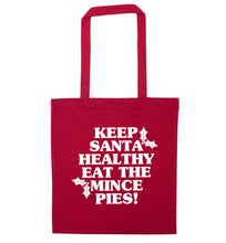 Keep santa healthy eat the mince pies red tote bag