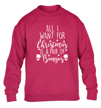 All I want for Christmas is a pair of bongos! children's pink sweater 12-14 Years