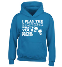 I play the bongos what's your superpower? children's blue hoodie 12-14 Years