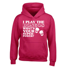 I play the bongos what's your superpower? children's pink hoodie 12-14 Years