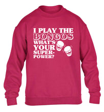 I play the bongos what's your superpower? children's pink sweater 12-14 Years