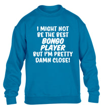 I might not be the best bongo player but I'm pretty close! children's blue sweater 12-14 Years