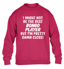 I might not be the best bongo player but I'm pretty close! children's pink sweater 12-14 Years