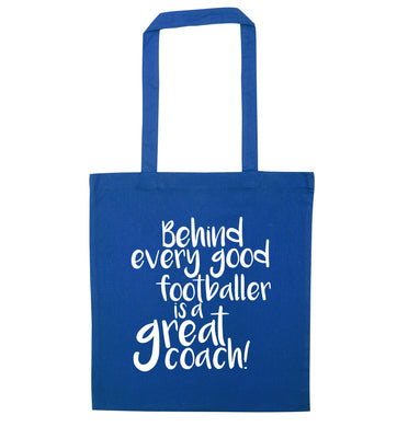 Behind every good footballer is a great coach! blue tote bag