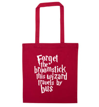 Forget the broomstick this wizard travels by bus red tote bag