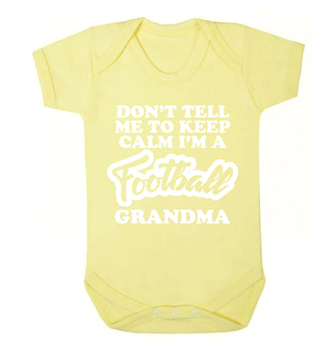 Don't tell me to keep calm I'm a football grandma Baby Vest pale yellow 18-24 months